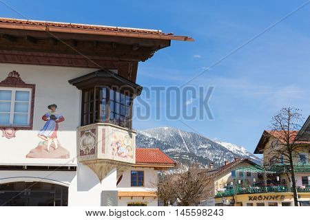 GARMISCH-PARTENKIRCHEN GERMANY - APRIL 03 2015: Garmisch-Partenkirchen is a mountain resort town in Bavaria southern Germany.The village is a host to the leaders of the world's largest economic powers G7