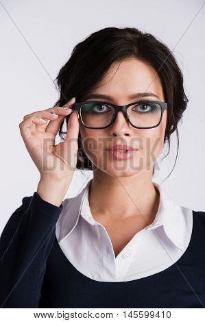 Young attractive happy woman trying on new glasses.