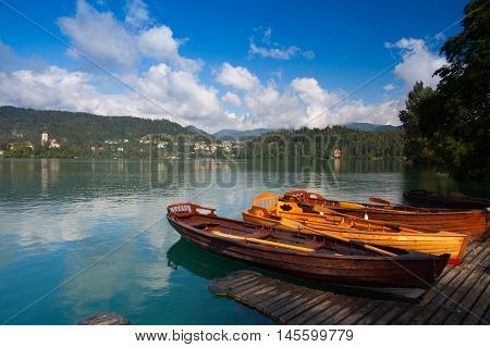 Typical wooden boats at the pier of the Bled Island Lake Bled Slovenia.