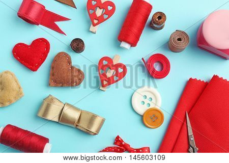Handcraft flat lay in red colour on turquoise background