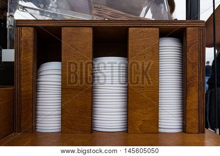 Stacked Coffee Lids Holder Increasing Pattern Bars