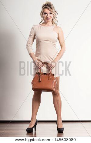 Mature Elegant Woman Holds Handbag