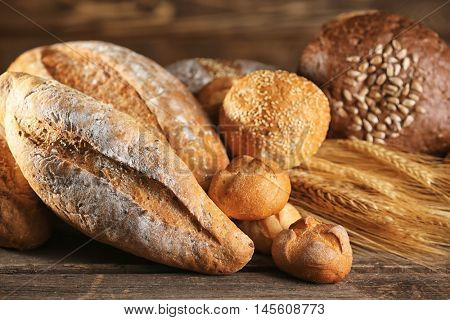 Lots of bread and spikes on the wooden table