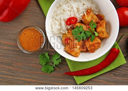 Tasty dinner with chicken curry and rice in plate