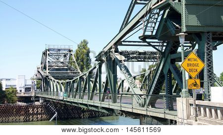 Walnut Grove CA - August 06 2016: Bascule bridge commonly know as a drawbridge over the Sacramento River on Walnut Grove Crossing in Walnut Grove