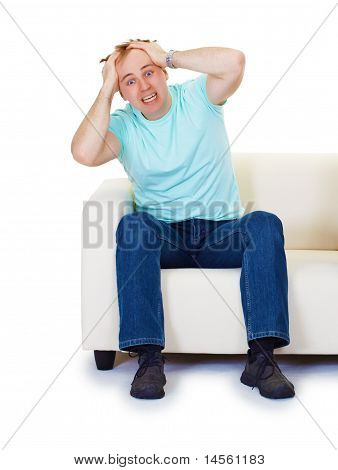 Nervous Hysteria Man At Home On Sofa Isolated On White