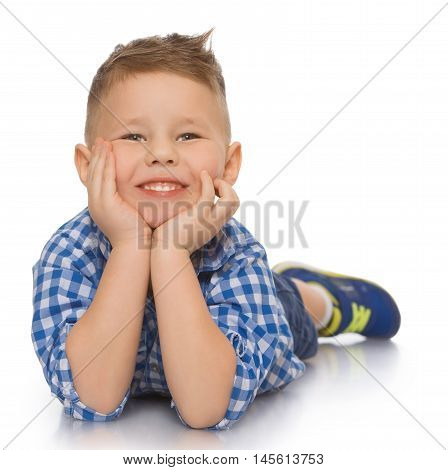 Beautiful little boy in shirt and shorts lying on the floor. He put his head in his hands and looks straight into the camera - Isolated on white background