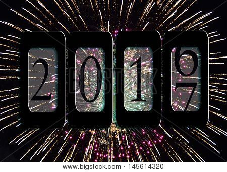 New Year 2017 odometer with fireworks in black sky