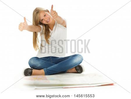 Young girl sitting on the floor with thumbs up in front of map over white background
