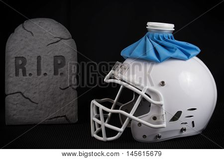 American football white helmet with a ice pack, having a bad season or hurt player, black backdrop