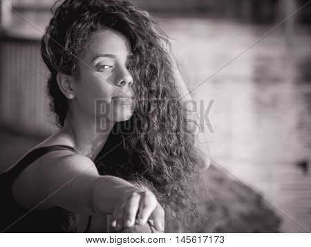 monochrome portrait of Latina woman with her hair over her face