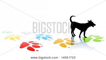 Editable vector illustration of a young dog silhouette and colorful paw prints with space for text