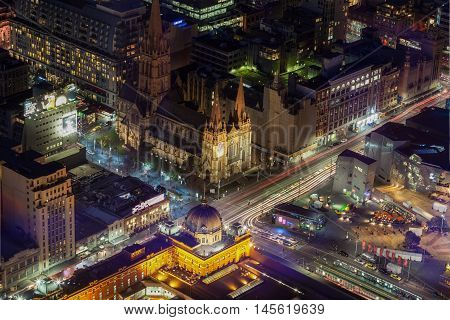 Aerial View Of Flinders Street Station And St. Pauls Cathedral At Night.