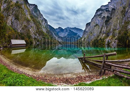Boat garage on the lake. Pretty Obersee lake in the Bavarian Alps. The concept of active tourism and ecotourism
