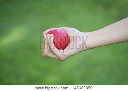 close up woman hand squeezing a stress ball