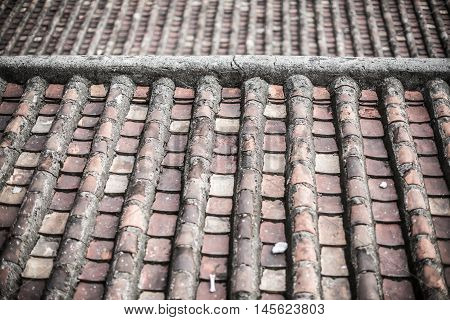 Background of old roof tiles in rows
