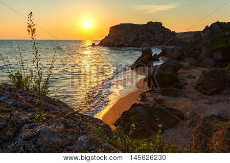 Sun rises over the Sea of Azov on Generals beach. Karalar regional landscape park in the Crimea.