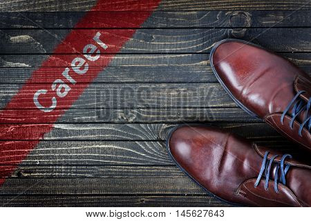 Career message and business shoes on wooden floor