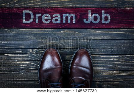 Dream Job message and business shoes on wooden floor