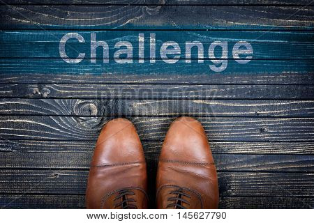 Challenge message and business shoes on wooden floor