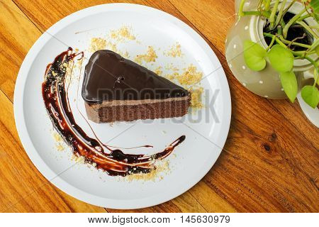 chocolate cake with chocolate sauce on white plate