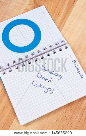 Polish Inscription World Diabetes Day In Notebook And Blue Circle, Symbol Of Diabetic