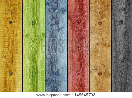 Old boards painted in different colors. Background old panel with rusty nails