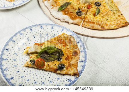 Vegetarian pizza ready to serve on plate