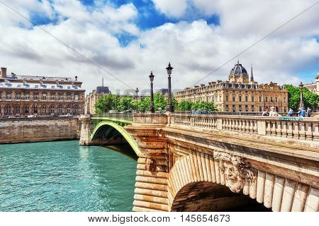 Paris, France- July 04, 2016 : River Seine, Registry Of The Paris Commercial Court And Bridge Of Cha