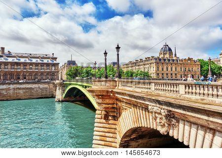 Paris, France- July 04, 2016 : River Seine, Registry Of The Paris Commercial Court And Bridge Of Cha