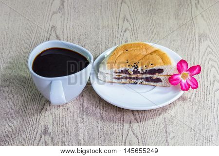 Black coffee and Bread stuffed with red beans