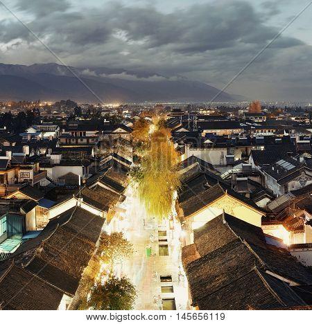 Dali old town rooftop view at dusk. Yunnan, China.