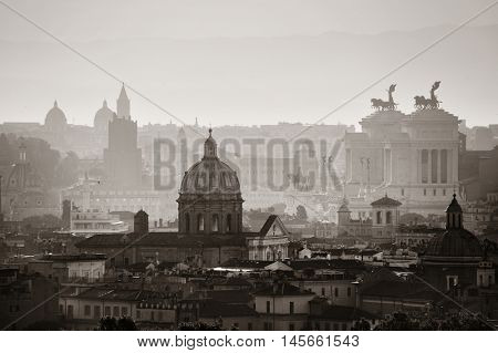 Rome rooftop view at sunrise silhouette black and white with ancient architecture in Italy.