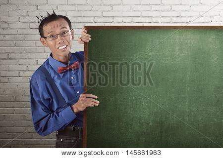 Nerd Man Wearing Suspender And Bow Tie