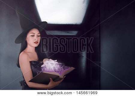 Sexy Witch Woman Spell With The Book In The Dark Room