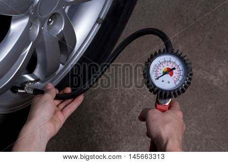 inflating the automobile wheels via a pump