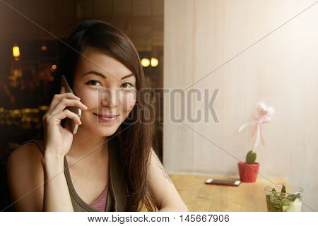 People And Communication Concept. Headshot Of Beautiful Young Female Making Phone Calls, Talking To