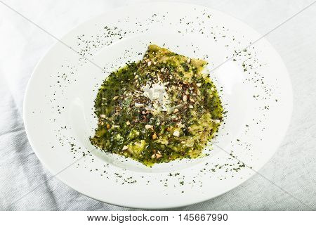 Sicilian ravioli stuffed with arugula ricotta and almonds