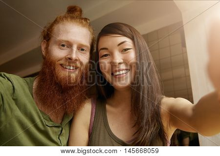 Young Good-looking Hipster Man Wearing Casual Shirt Posing Together With His Best Female Friend With