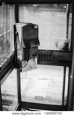 dirty old public telephone in thailandblack and white color picture styleselective focusneglected item in thailand