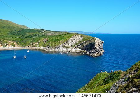 LULWORTH COVE, UNITED KINGDOM - JULY 19, 2016 - Elevated view of the cove entrance Lulworth Cove Dorset England UK Western Europe, July 19, 2016.