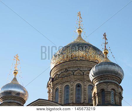 Photo of golden doms of russian church. Saint-Petersburg church.