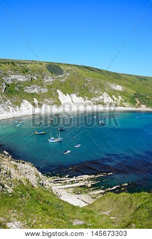 LULWORTH COVE, UNITED KINGDOM - JULY 19, 2016 - Elevated view of boats moored in the cove Lulworth Cove Dorset England UK Western Europe, July 19, 2016.