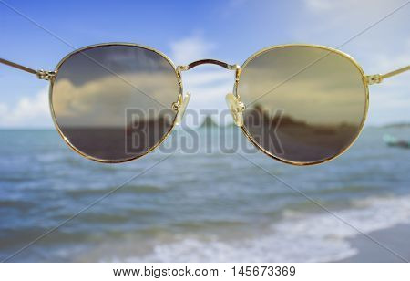 sunglasses front of the camera looked like wearing a sunglasses blurred sea in background