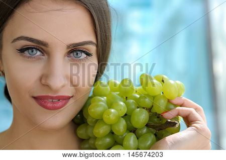 She Put A Bunch Of Ripe Grapes On Her Left Shoulder