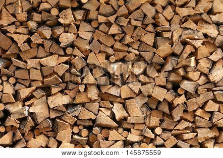 Chopped brown stack of wood detailed background texture.