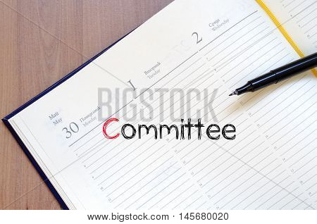 Committee text concept write on notebook