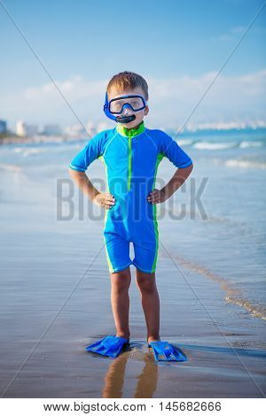 Kid in swimming suit is ready for snorkeling