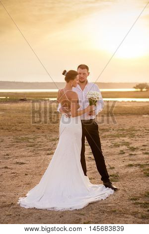 Couple in the sunset light wedding photosession