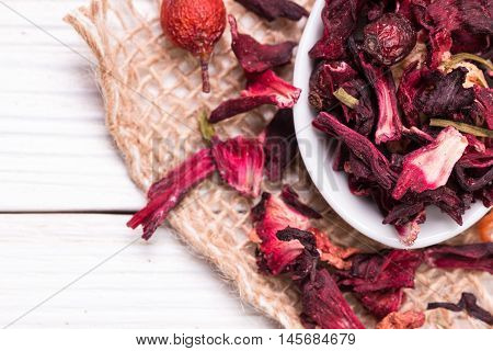 Mixture herbal floral fruit tea with petals dry berries and fruits.